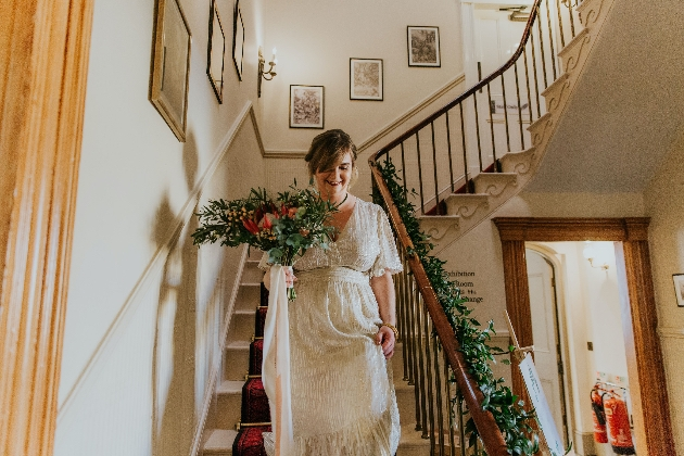 Bride walking down the stairs inside Gaskell's House