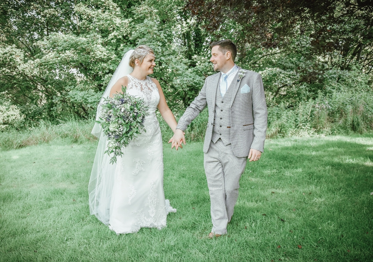 Bride and groom on green