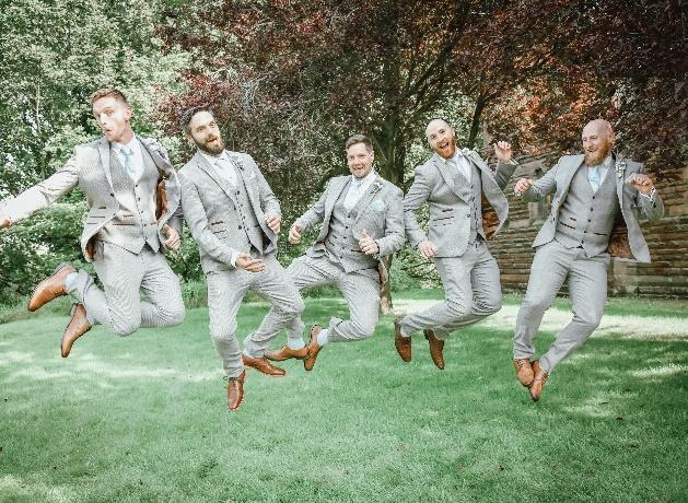 Groomsmen jumping in the air